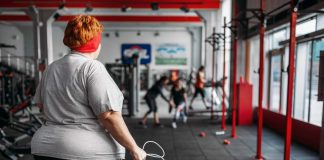 Obese woman working out in gym