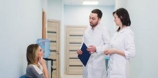 female patient being reassured by doctors