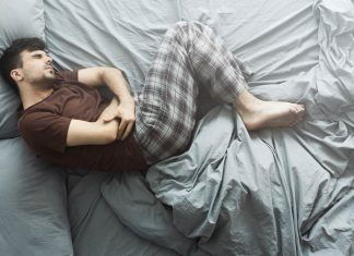 man lying in bed with acidity