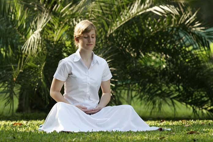 Meditating Girl in White