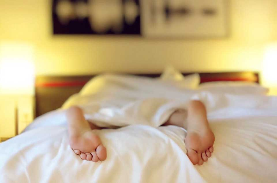 Sleeping Person on Bed