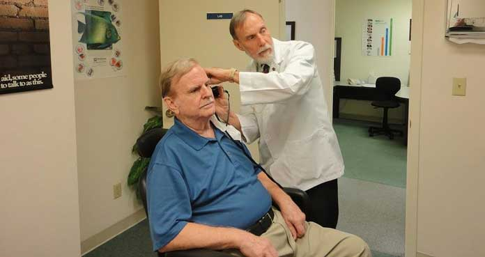 Audiologist Checking Ear