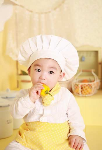 Kid in Chef Dress