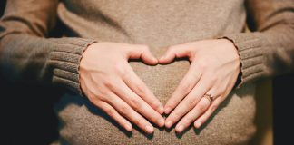 Pregnant woman making heart