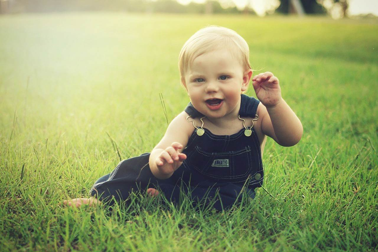 Baby playing in lawn