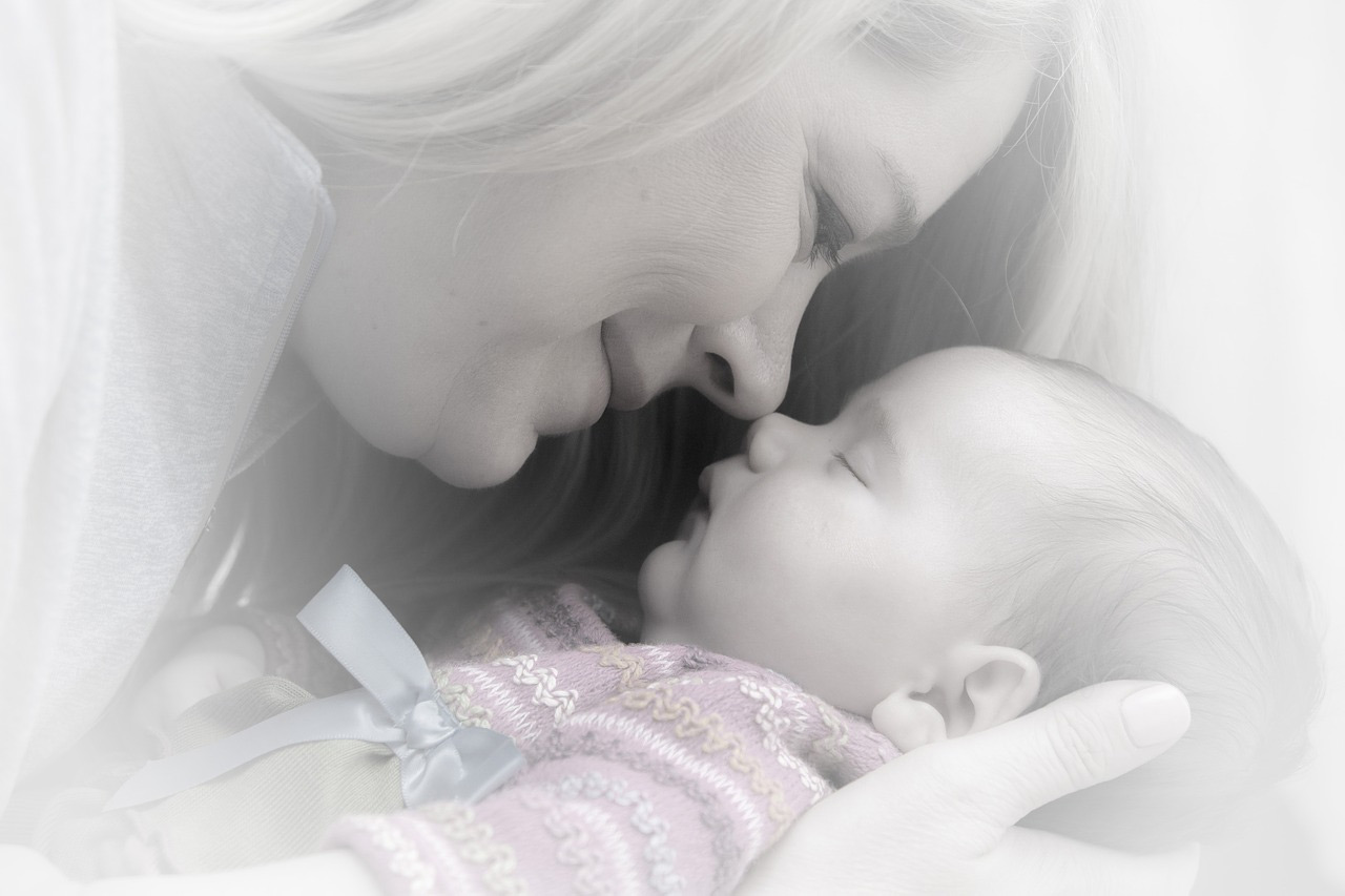 Mother cuddling baby