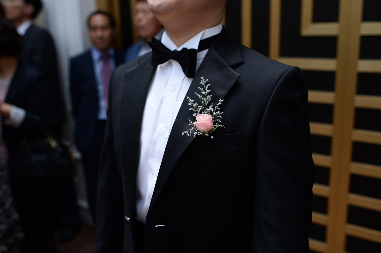 Black suit with lapel brooch