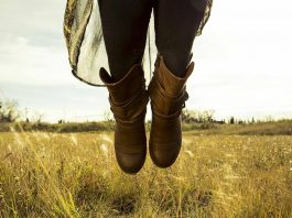 Girl jumping in boots