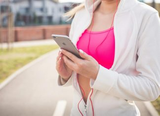 Girl jogging and using Apple smartphone