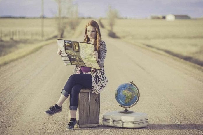 Traveller girl looking at map