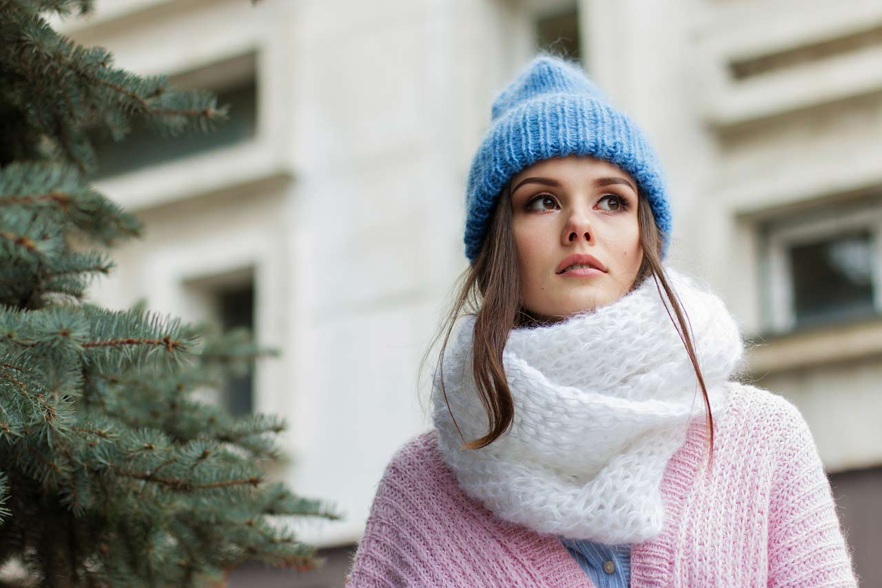 Girl in winter clothes and scarf