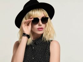 Fashionable girl in sunglasses-and-hat