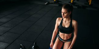Young woman workout in fitness club