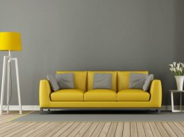 gray living room with yellow sofa