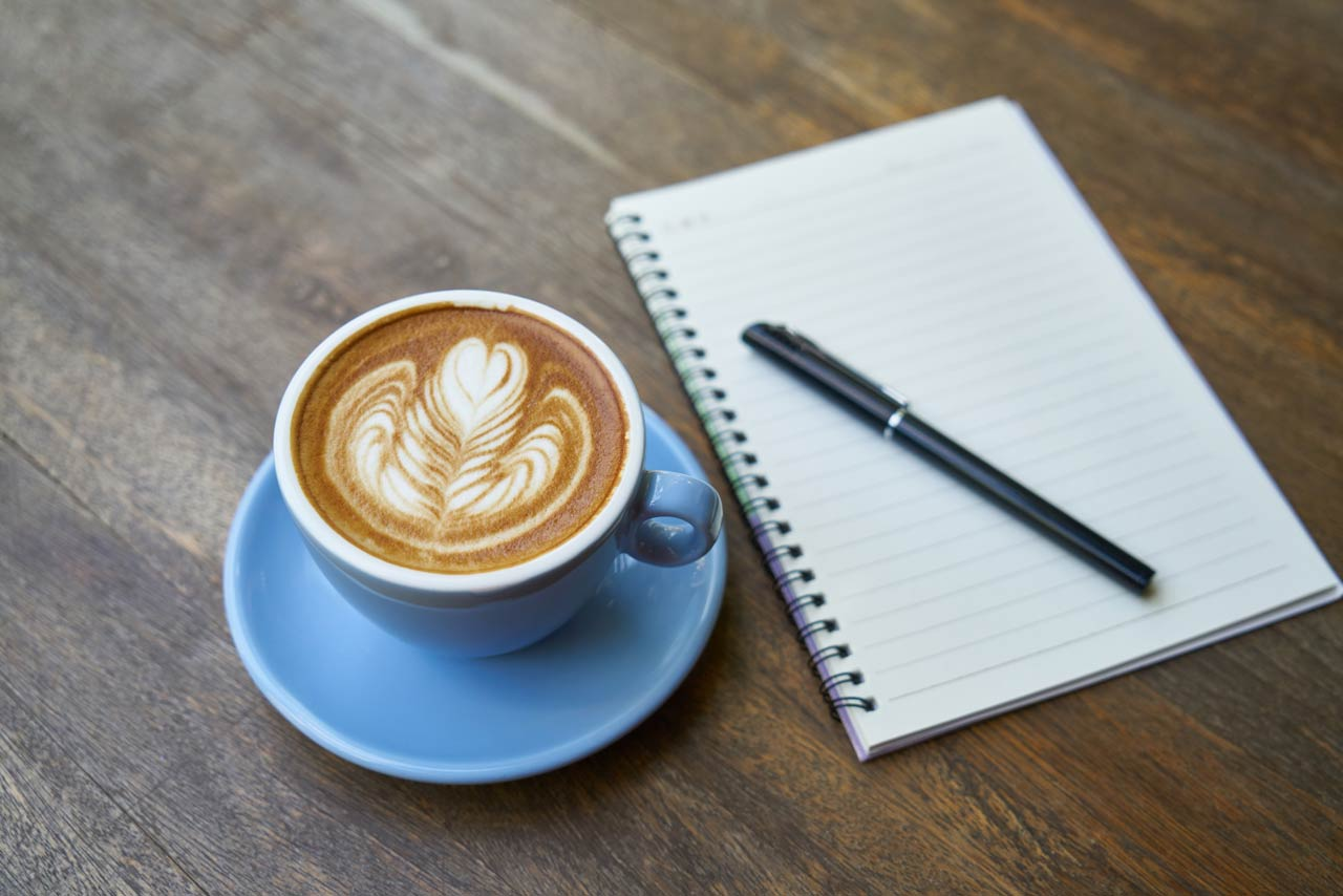 journal writing with coffee