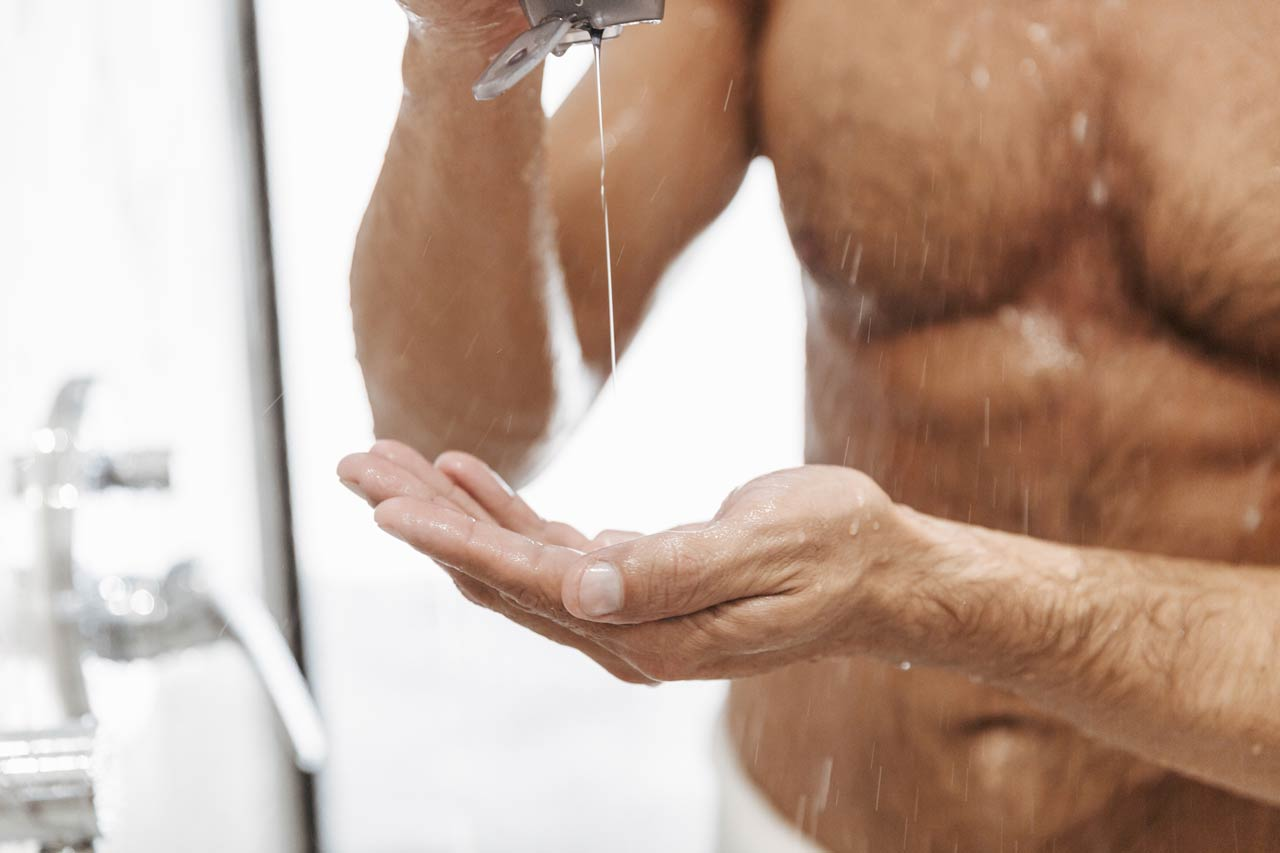 man using shower gel