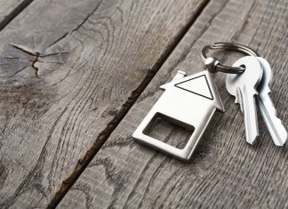 bunch-of-keys-with-house-shaped-keychain-on