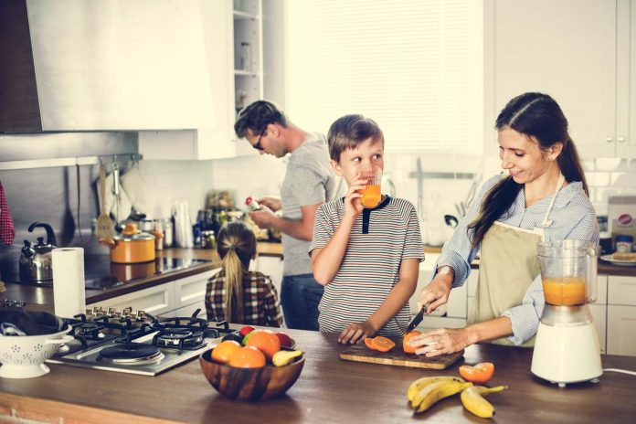 Family together in kitchen