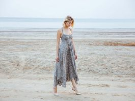 woman in beautiful long dress walking tiptoes