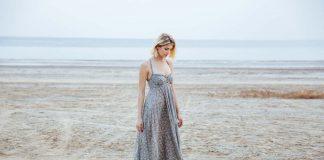 woman in beautiful long dress walking tiptoes