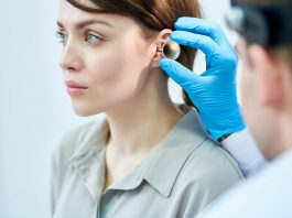 audiologist examining ears