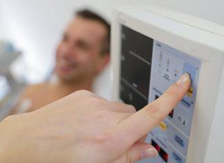 healthcare provider pressing the machine