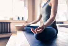 woman doing yoga exercises in gym closeup sport