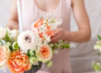 woman hands touching a bouquet of flowers