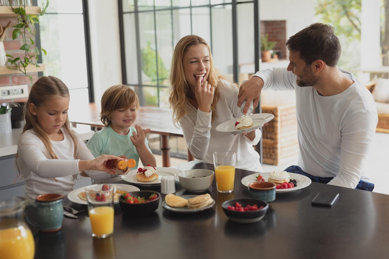 caucasian family having food at dining table