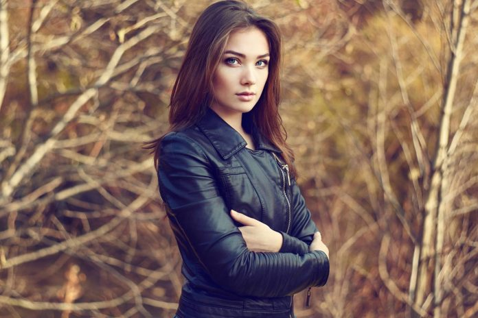 portrait of young beautiful woman in leather