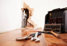 tools and toolbox lying on flood damaged floor