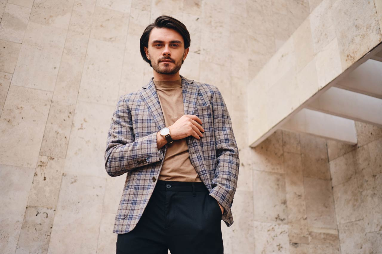 young attractive stylish man in checkered jacket