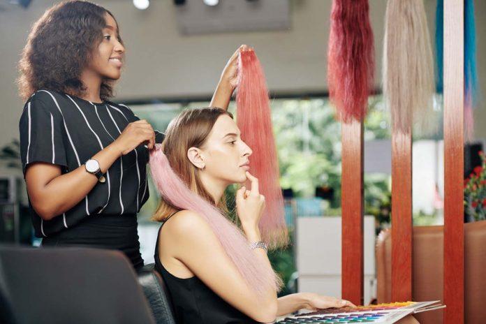 pensive woman choosing hair extensions